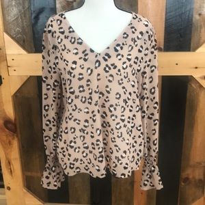 Leopard print v neck tunic with bell sleeves